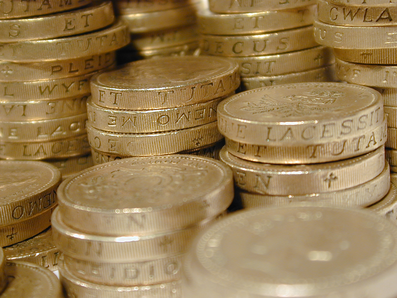 Pound coin, Unemployment, Slow Economic Growth